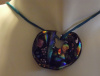 Kidney shaped dichroic pendant on a blue cord